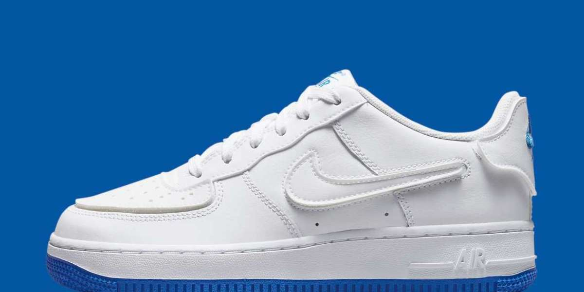 "DB4545-105 A child's Nike Air Force 1 has a ""Sapphire Blue"" bottom and interchangeable soles"